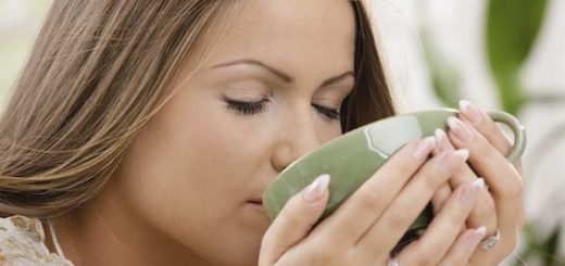 Closeup portrait of beautiful girl drinking tea from green cup. Click here for more images of this model:  [url=my_lightbox_contents.php?lightboxID=5544150][img]http://www.nitorphoto.com/istocklightbox/bobe.jpg[/img][/url]